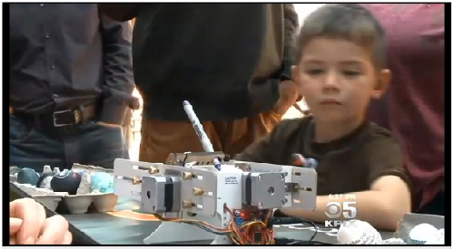 Kid watching Eggbot on CBS for Robot Block Party