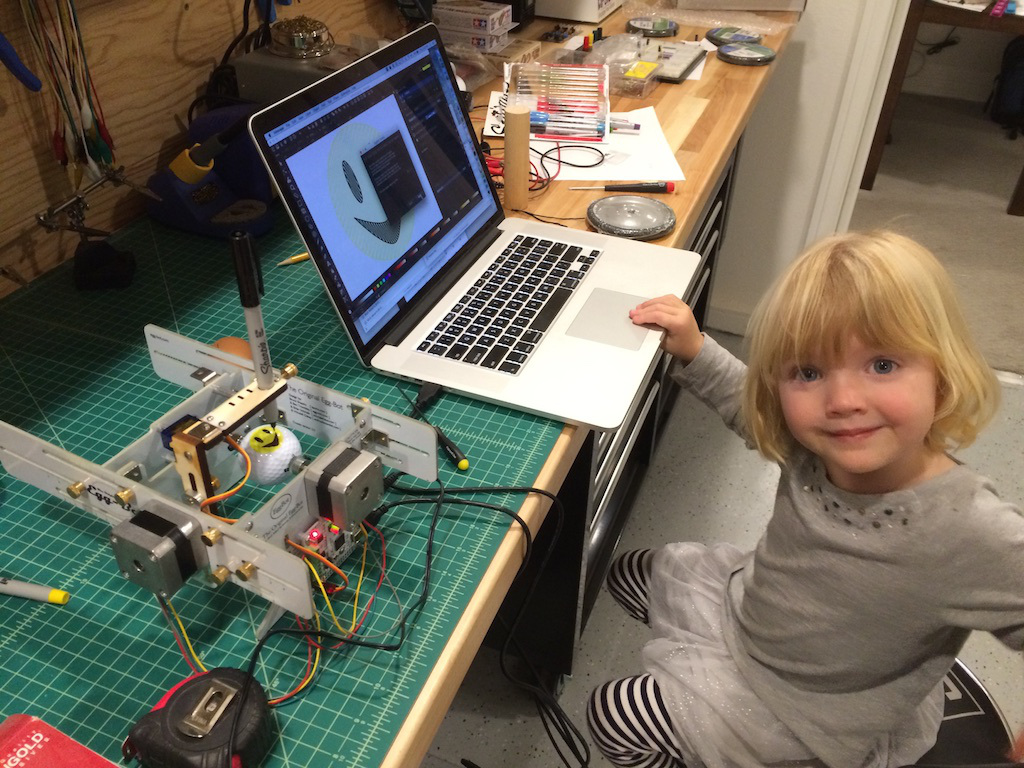 EggBot on workbench with daughter at computer