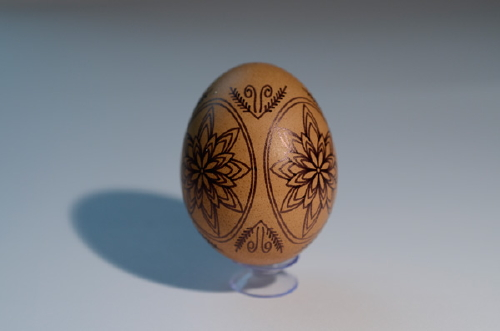 Brown egg with black ink pattern