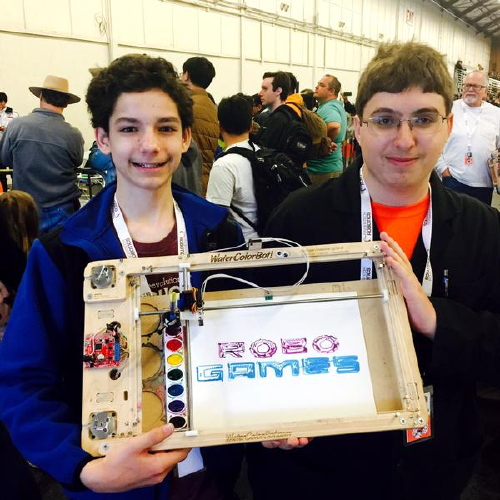 Schuyler and Roger show off the RoboGames logo as drawn by the WaterColorBot
