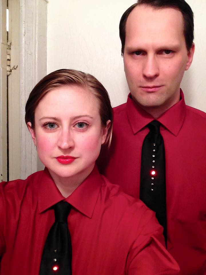 Man and woman dressed as Kraftwerk band members