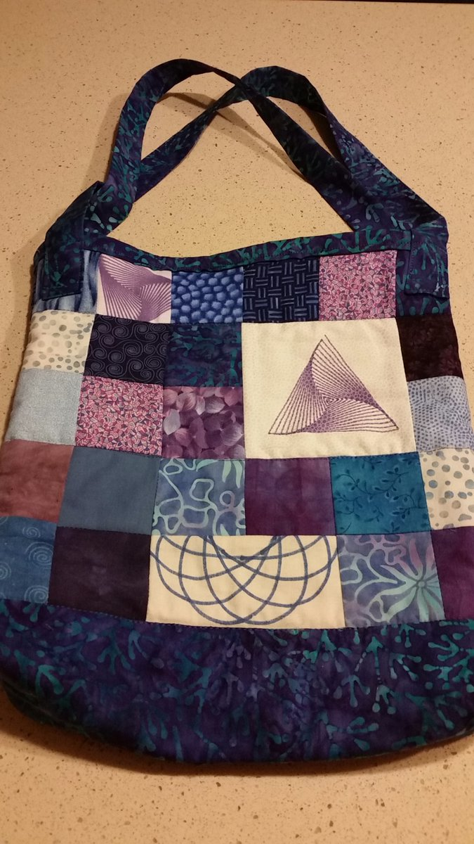 Quilted bag with geometric patterns drawn by WaterColorBot